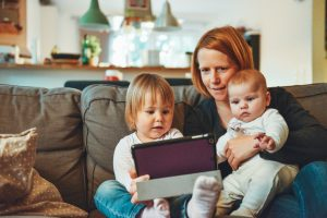 Mom and children reading tablet