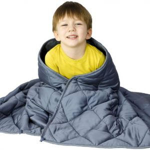 Child using a weighted blanket